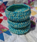Our Shallow Aqua and Yellow Baskets are perfect to stash keys, cell phone, or other small items or trinkets.  They are crocheted using two strands of yarn for stiffness.